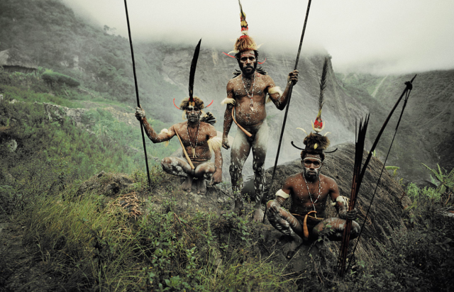 A photograph of three Dani Tribe members (taken by Jimmy Nelson)