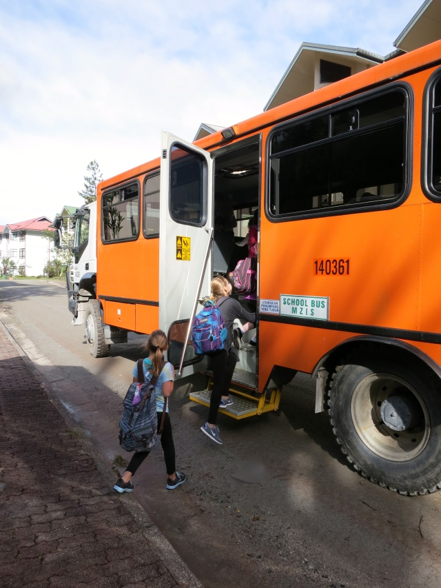 Ally and Kylee boarding the monster school bus.