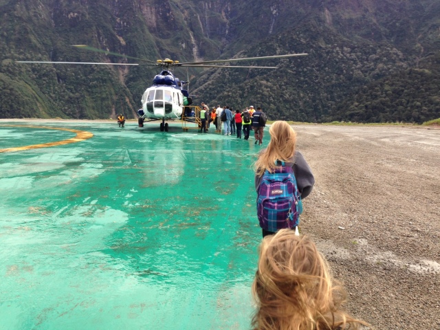 The girls walking towards the helicopter.