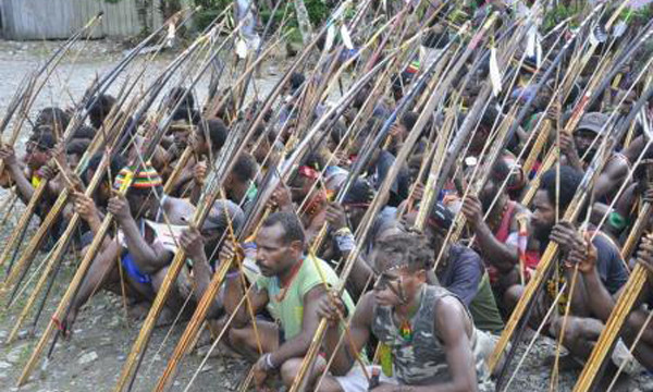 Indigenous Papuans and their traditional weapons (IST)