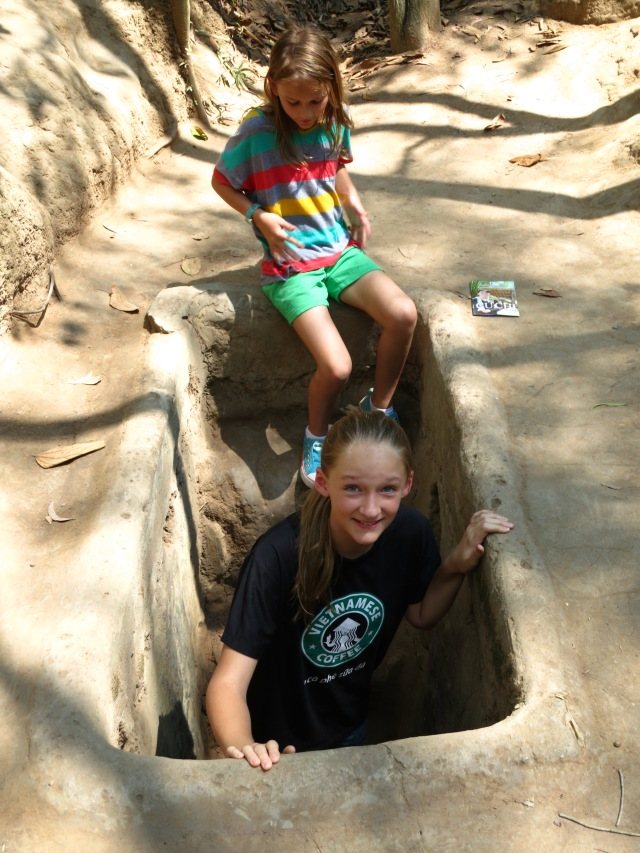 Kylee and Ally entering the Cu Chi Tunnels.