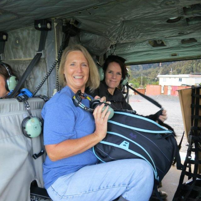 Carol and me preparing for the chopper flight down to the village.