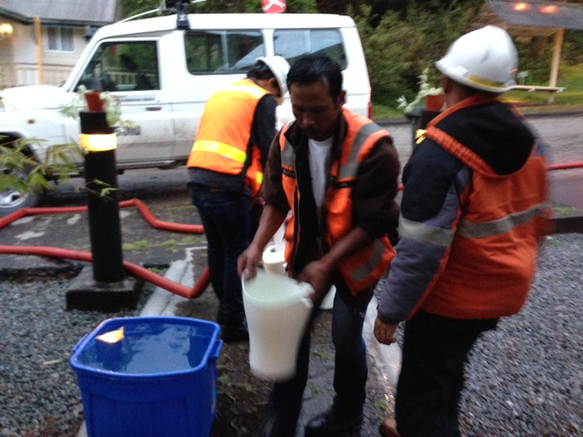 Town management employees filling our containers with water.