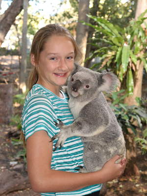 Ally cuddling a koala at Lone Pine Koala Sanctuary in Brisbane.