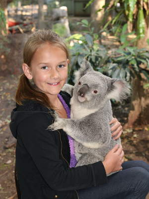 Kylee cuddling a koala at the Lone Pine Koala Sanctuary in Brisbane.