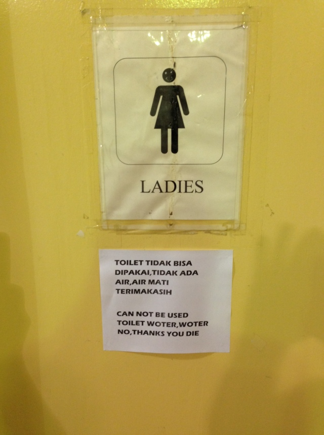 This sign was posted on the ladies' bathroom door when the water system was decimated during the landslide.