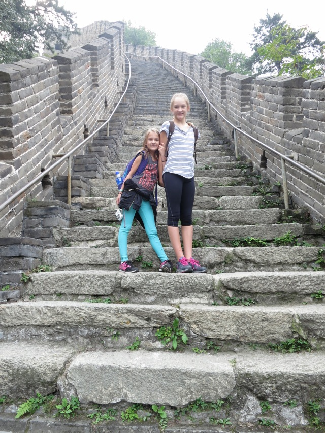 Ally and Kylee standing on the Great Wall of China.