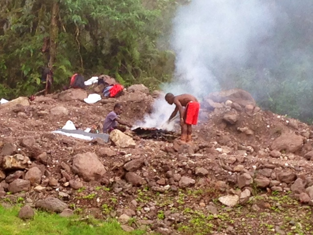 The men took a short break to cook ayam (chicken) over a fire.  After a short lunch break, they went back to work.  The Papuans are hard, dedicated workers.