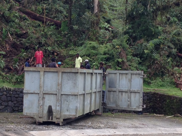 The company provided the container and a truck to transport the timber to the village.