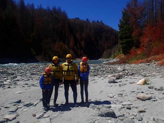 The four of us dressed in wet suits, fleece jackets (Kylee and me), life jackets, and neoprene booties. The scene from the Fellowship of the Ring was shot here.  It is the scene where Arwin helps Frodo cross the river to