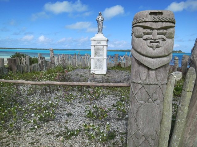 The statue of St Maurice (in the background), commemorates the arrival of the first missionaries on the island. The statue is surrounded by hand carved totems made by the numerous clans of the island.