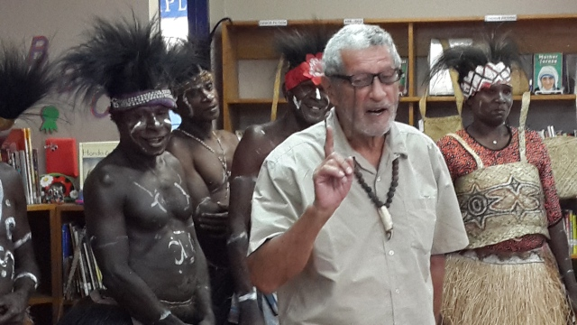 Dr. Kal Muller, flanked by a Komoro man and a Komoro .