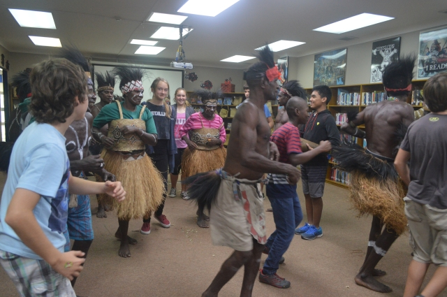 Ally and the other middle school students dancing with the Komoro men and women.