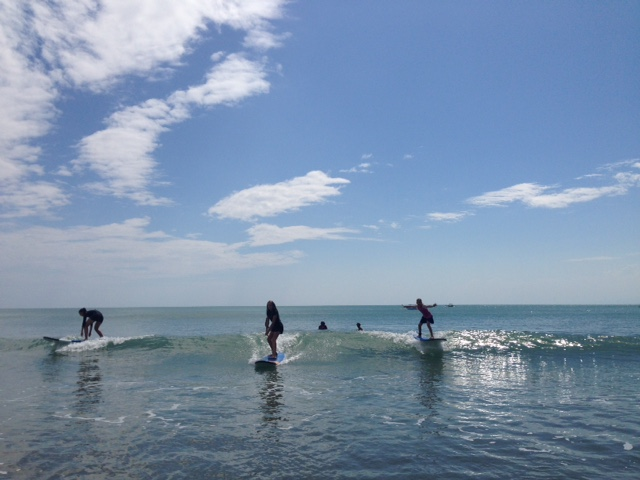 Summer (left), Ally (middle), and Kylee (right) on their surfboards. All three girls caught every single wave they attempted to ride. Best surfing ever!