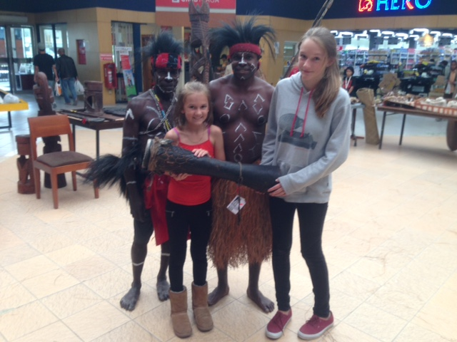 Ally and Kylee with two of the Papuan men who were involved in the drum skinning presentation. The man of the left is Herman, one of Dr. Muller's biggest supporters. The girls are holding the drum, which we were able to purchase, that was used in the presentation