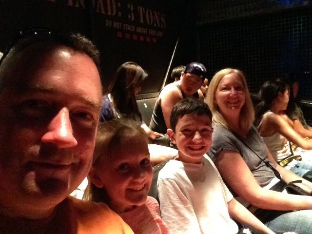 Chris, Kylee, Alex, and Chris's sister, Wendy, waiting to begin their Tower of Terror ride.