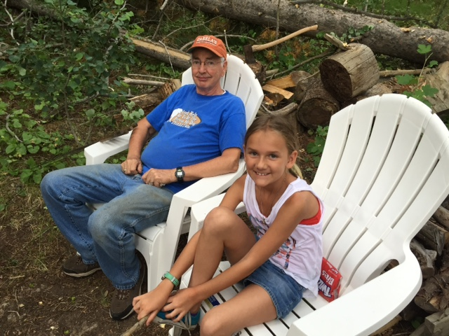 Kylee and Grandpa Dave enjoying the campfire.