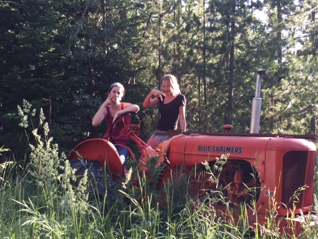 Ally and her cousin, Katelyn, playing on Grandpa Dave's tractor.