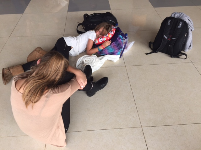 Ally and Kylee, physically tired and emotionally exhausted from the chaos in Makassar. In this picture, they are grabbing a few weeks on the floor of the Makassar airport while waiting for the shuttle to pick us up.